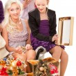 Stock Photo: Young family having fun with Christmas presents.