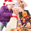Young family having fun with Christmas presents. — Stock Photo