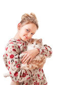 Little girl with a kitten. — Stock Photo