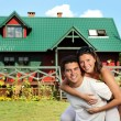 Young couple and their house — Stok fotoğraf