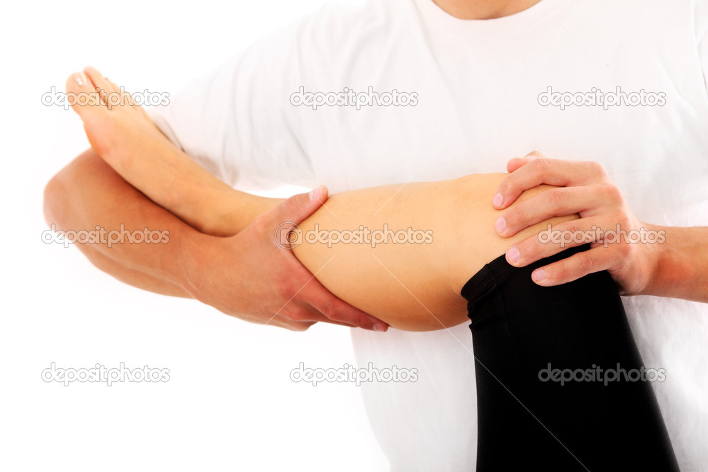 A picture of a physio therapist trying to fix the leg over white background — Stock Photo #6862919