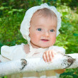 Infant girl enjoying sunny day in forest — Stock Photo