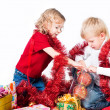 Royalty-Free Stock Photo: Adorable kids preparing for Christmas isolated on white