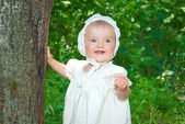 Infant girl wearing vintage clothes enjoying sunny day in forest — Stock Photo