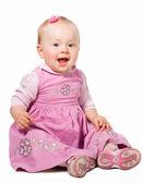 Happy infant girl sitting isolated on white background — Stock Photo