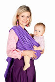Young mother with baby in sling isolated on white studio background — Stock Photo