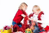 Adorable kids preparing for Christmas isolated on white — Stock Photo