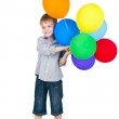 Happy boy standing with balloons isolated on white background — Stock Photo #7296894