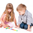 Two playing kids with alphabet isolated on white background — Stock Photo