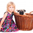 Isolated portrait of little girl hugging dog on white background — Stock Photo