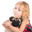 Isolated portrait of pretty girl hugging pug dog on white background — Stock Photo