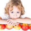 Cute little girl with bunch of apples isolated on white — Stock Photo