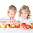 Two siblings choosing with apples isolated on white — Stock Photo