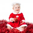 Royalty-Free Stock Photo: Happy new year infant girl wearing Santa suit sitting on floor