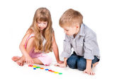 Two playing kids with alphabet isolated on white background — Stok fotoğraf