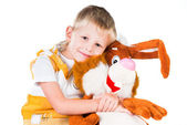 Little boy with a toy rabbit isolated on white background — Stock Photo