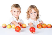 Two kids offering apples isolated on white — Stock Photo