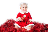 Happy new year infant girl wearing Santa suit sitting on floor — Stock Photo