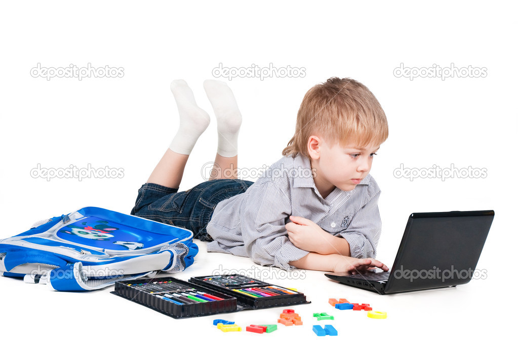 Little schoolboy learning with laptop isolated on white background — Stock Photo #7296912
