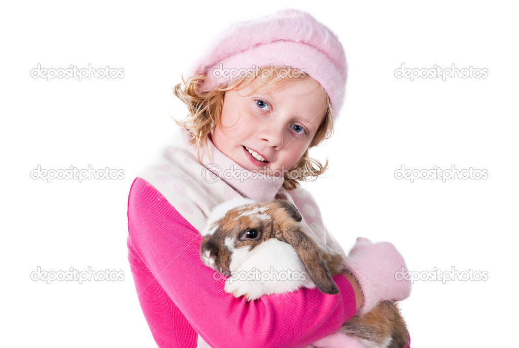 depositphotos 7297071 Cute teen girl wearing winter apparel carrying rabbit isolated on white Cute teen girl smiling at the camera sitting in her car outdoor