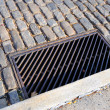 Stock Photo: Metal Storm Drain on Historic Cobblestone Street in Pennsylvania
