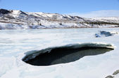 Hole in Alaska River Ice during Spring Breakup — ストック写真