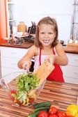 Girl making salad — Stock Photo