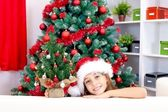 Girl with small Christmas tree — Stock Photo