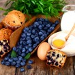 Blueberry muffin with ingredients — Stock Photo