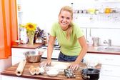 Sexy woman baking cake — Stock Photo