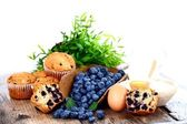 Blueberries and muffins — Stock Photo