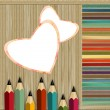 Colored pencils on a wooden background — Stock Photo #6937573