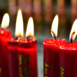 Big red burning candles in temple — Stock Photo #6926081