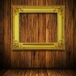 Stock Photo: Old antique gold frame on wood wall
