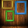 Stock Photo: Old antique colorful frame on wood wall