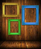 Old antique colorful frame on wood wall — Stock Photo