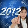 Young woman with new year background — Stock Photo