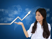 Business woman and a graph — Stock Photo