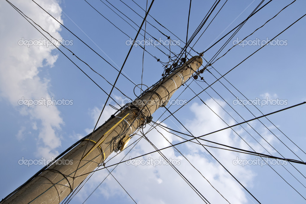 Column with a set of electrical wires in a different direction. — Stock Photo #6929284