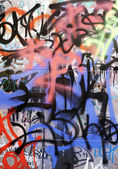 Abstract background with a piece of graffiti. — Stock Photo