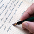 Hand with pen writes letter. — Stock Photo