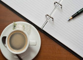 Note and coffee — Stock Photo