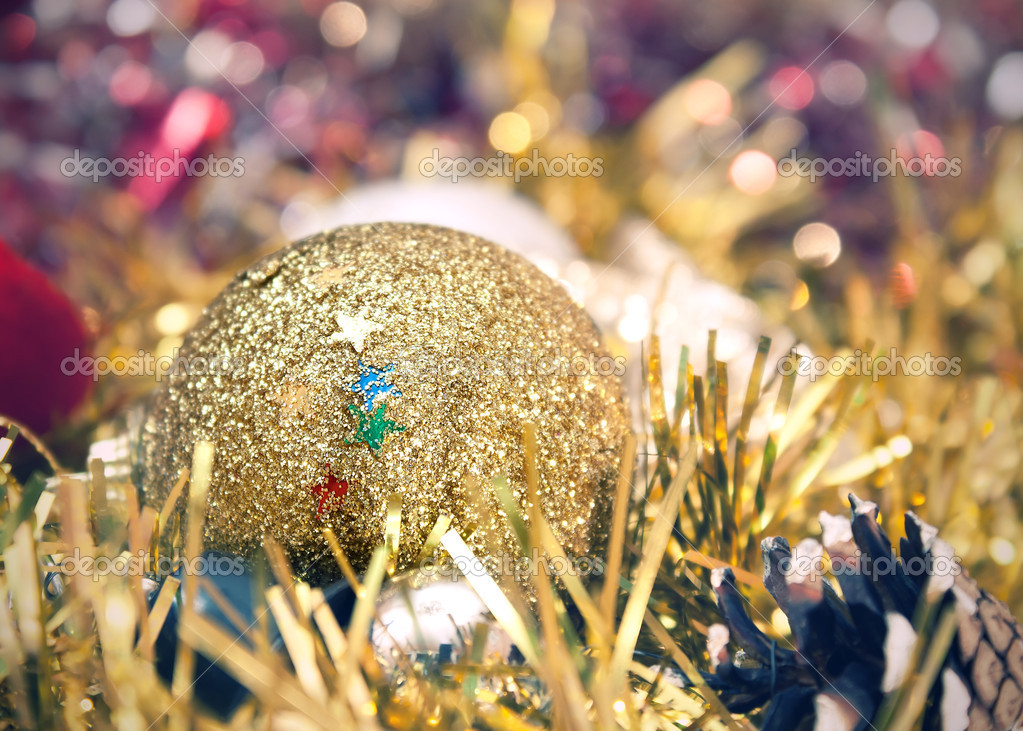 Golden christmas ball over light background — Stock Photo #6985748