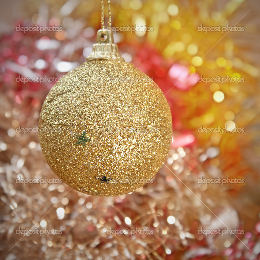Yellow Christmas tree decorations on lights background — Stock Photo #6985814