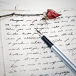 Love letter with a rose — Stock Photo
