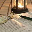 An open old book by the candlelight — Stockfoto #7511479