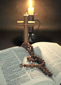 Rosary on bible — Stock Photo