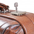 Old leather suitcase with key — Stock Photo