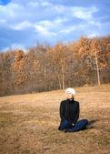 Beautiful woman enjoying the warm autumn sun — Stock Photo