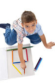 Boy playing with crayons — Stock Photo
